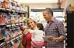 Family shopping for juice in supermarket Stock Photo - Premium Royalty-Free, Artist: Blend Images, Code: 635-05972390