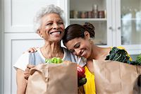 Mother and daughter unpacking groceries in kitchen Stock Photo - Premium Royalty-Freenull, Code: 635-05972391