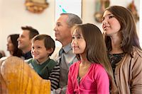 Family sitting together in church Stock Photo - Premium Royalty-Freenull, Code: 635-05972413