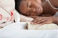 Girl asleep with Bible in bed Stock Photo - Premium Royalty-Freenull, Code: 635-05972420