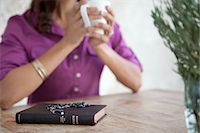 Prayer beads on Bible at breakfast table Stock Photo - Premium Royalty-Freenull, Code: 635-05972428