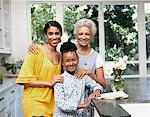Older woman with daughter and granddaughter in kitchen Stock Photo - Premium Royalty-Free, Artist: Blend Images, Code: 635-05972465