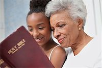 Older woman and granddaughter reading Bible together Stock Photo - Premium Royalty-Freenull, Code: 635-05972493