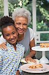 Older woman and granddaughter having pie Stock Photo - Premium Royalty-Free, Artist: Blend Images, Code: 635-05972504