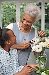Older woman and granddaughter arranging flowers Stock Photo - Premium Royalty-Free, Artist: Robert Harding Images, Code: 635-05972508