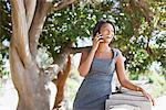 Businesswoman talking on cell phone outdoors Stock Photo - Premium Royalty-Free, Artist: Blend Images             , Code: 635-05972536