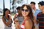 Woman eating ice cream cone outdoors Stock Photo - Premium Royalty-Free, Artist: Blend Images, Code: 635-05972646