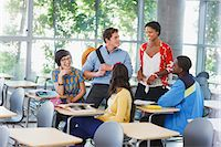 Students talking in classroom Stock Photo - Premium Royalty-Freenull, Code: 635-05972703