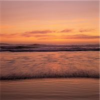 Waves rolling on beach at sunset Stock Photo - Premium Royalty-Freenull, Code: 635-05972708