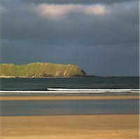 Waves washing up on beach Stock Photo - Premium Royalty-Freenull, Code: 635-05972740