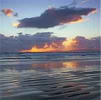 Waves washing up on beach Stock Photo - Premium Royalty-Freenull, Code: 635-05972755