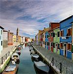 Gondolas docked in urban canal Stock Photo - Premium Royalty-Free, Artist: Jose Luis Stephens, Code: 635-05972880