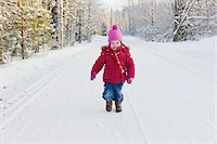Portrait of Little Girl Walking Down Road in Winter Stock Photo - Premium Royalty-Freenull, Code: 600-05973087