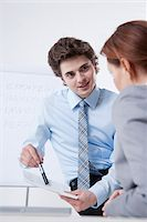Young Businessman giving Presentation to Businesswoman Stock Photo - Premium Royalty-Freenull, Code: 600-05973117