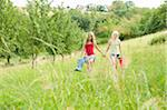 Two Girls Holding Hands and Walking in Field Stock Photo - Premium Rights-Managed, Artist: Bettina Salomon, Code: 700-05973437