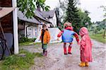 Three Children Playing in Puddles Stock Photo - Premium Rights-Managed, Artist: Burazin, Code: 700-05973446