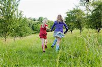 family shoes - Two Girls Running in Field Stock Photo - Premium Rights-Managednull, Code: 700-05973507