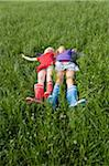 Two Girls Lying in Grass