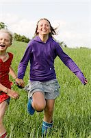 Two Girls Running in Field Stock Photo - Premium Rights-Managednull, Code: 700-05973512