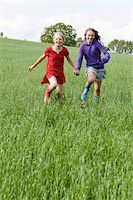 family shoes - Two Girls Running in Field Stock Photo - Premium Rights-Managednull, Code: 700-05973513