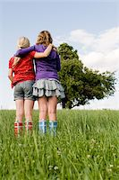 Two Girls Standing in Field Stock Photo - Premium Rights-Managednull, Code: 700-05973514