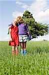 Portrait of Two Girls Standing in Field