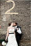 Bride and Groom Kissing Stock Photo - Premium Rights-Managed, Artist: Ikonica, Code: 700-05973652