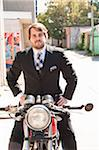 Man Wearing Suit Sitting on Motorcycle Stock Photo - Premium Rights-Managed, Artist: Ikonica, Code: 700-05973653