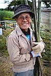 Portrait of Man Holding Pieces of Bamboo, Inutabu, Tokunoshima Island, Kagoshima Prefecture, Japan Stock Photo - Premium Rights-Managed, Artist: R. Ian Lloyd, Code: 700-05973995