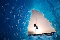 COMPOSITE: View from inside an ice cave of an iceberg frozen in Mendenhall Lake as an ice climber rappels down a rope, Juneau, Southeast Alaska, Winter Stock Photo - Premium Rights-Managednull, Code: 854-05974173