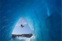 COMPOSITE: View from inside an ice cave of an iceberg frozen in Mendenhall Lake as an ice climber rappels down a rope, Juneau, Southeast Alaska, Winter Stock Photo - Premium Rights-Managednull, Code: 854-05974184