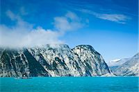 quest - Sea kayakers paddling along cliffs through Muir Inlet, Glacier Bay National Park & Preserve, Southeast Alaska, Summer Stock Photo - Premium Rights-Managednull, Code: 854-05974533