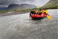 quest - Man packrafting the Sanctuary River in rainy weather, Denali National Park & Preserve, Alaska Range, Interior Alaska, Summer Stock Photo - Premium Rights-Managednull, Code: 854-05974564