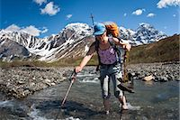 quest - Female backpacker crossing the Babel River below South Buttress on the western flanks of the Revelation Mountains, Summer in Southcentral Alaska Stock Photo - Premium Rights-Managednull, Code: 854-05974574