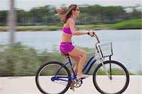 Girl cycling barefoot Stock Photo - Premium Royalty-Freenull, Code: 653-05975961