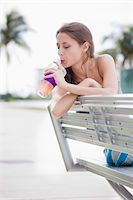 sucking - Girl sitting on bench drinking through straw Stock Photo - Premium Royalty-Freenull, Code: 653-05975964