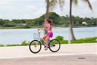 Girl cycling barefoot Stock Photo - Premium Royalty-Freenull, Code: 653-05975969