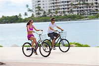 Girl and boy cycling on promenade Stock Photo - Premium Royalty-Freenull, Code: 653-05975973