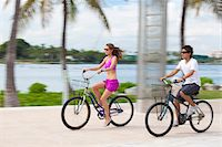 Boy and girl cycling on promenade Stock Photo - Premium Royalty-Freenull, Code: 653-05975974