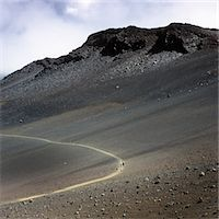extreme terrain - Hikers on a trail in the Haleakala National Park Stock Photo - Premium Royalty-Freenull, Code: 653-05976281