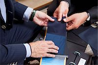 Detail of two men holding fabric samples Stock Photo - Premium Royalty-Freenull, Code: 653-05976665