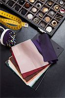 Detail of fabric samples, buttons, and other sewing equipment Stock Photo - Premium Royalty-Freenull, Code: 653-05976678