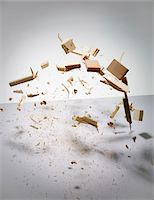 exploding - Wood exploding into pieces Stock Photo - Premium Royalty-Freenull, Code: 653-05976713