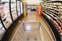 A shopping cart on an aisle in a supermarket, personal perspective Stock Photo - Premium Royalty-Freenull, Code: 653-05976758