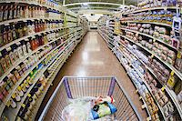 supermarket not people - A shopping cart on an aisle in a supermarket, personal perspective Stock Photo - Premium Royalty-Freenull, Code: 653-05976770