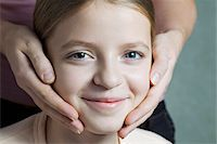 preteen touch - Portrait of daughter with Mother's hands on her cheeks Stock Photo - Premium Royalty-Freenull, Code: 653-05976870