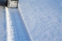 Tyre track on snow Stock Photo - Premium Royalty-Freenull, Code: 653-05976887