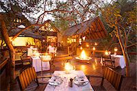 An outdoor dinning area, Pondoro Game Lodge, Balule Private Nature Reserve, Limpopo. South Africa Stock Photo - Premium Royalty-Freenull, Code: 682-05977077
