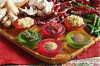spicy - Indian cooking. Garlic masala, green masala, red masala, ginger masala, dhania-jeero, gharum masala Stock Photo - Premium Royalty-Freenull, Code: 682-05977569