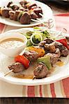 Traditional Karoo cooking. Ostrich sosaties - kebabs with peanut sauce Stock Photo - Premium Royalty-Free, Artist: Blend Images, Code: 682-05977577